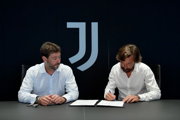 TURIN, ITALY - JULY 31: Andrea Agnelli and Andrea Pirlo during the signing of Andrea Pirlo as new U23...
