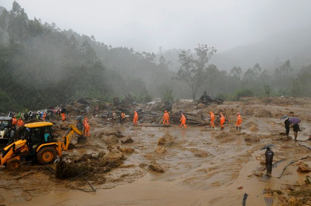 Rescuers work at the site of a mudslide triggered by heavy monsoon rain in Idukki, Kerala, Aug. 7,