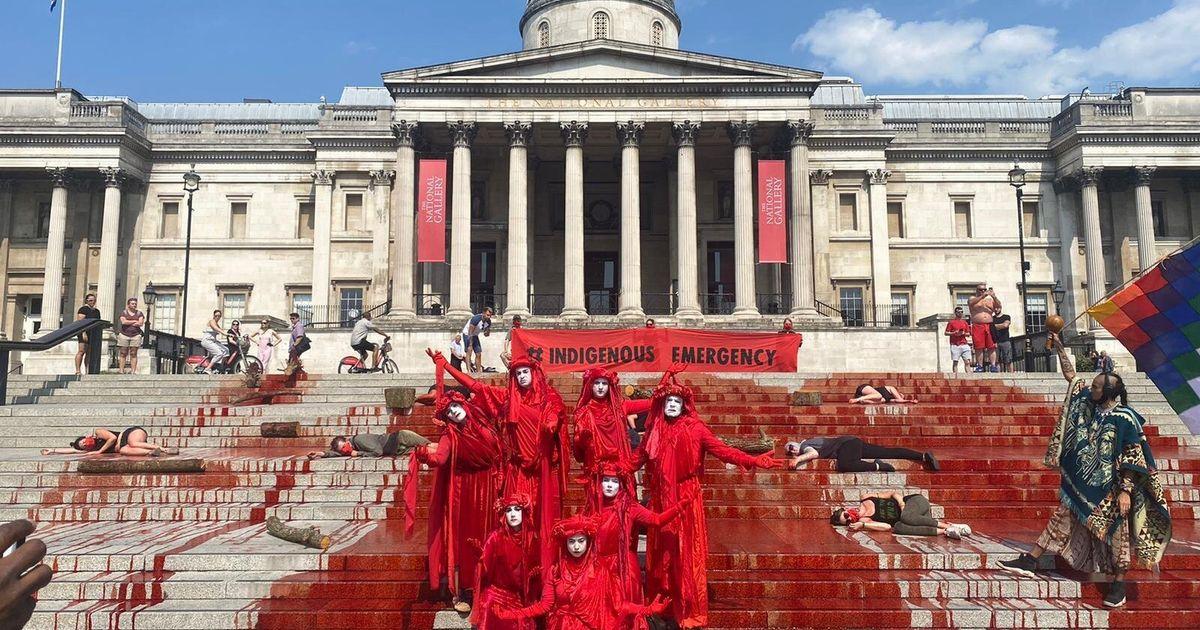 Extinction Rebellion Activists Drench Trafalgar Square In Fake Blood