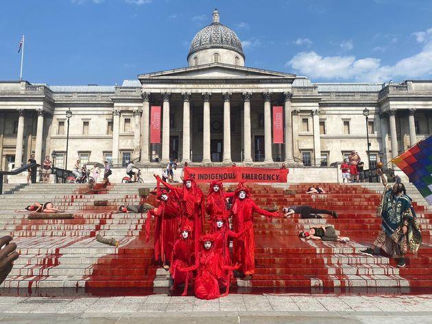 Extinction Rebellion protesters on the steps of Trafalgar