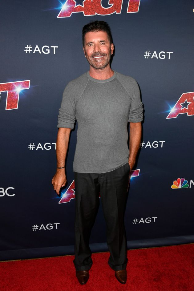 Simon Cowell broke his back Saturday in a fall from an electric