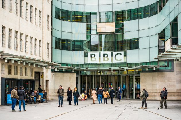 People outside the main entrance to the BBC's Broadcasting House building in central