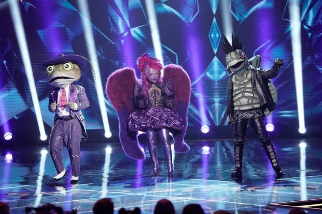 The US Masked Singer: L-R: The Frog, Night Angel and