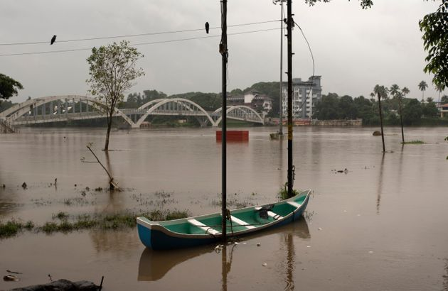 A boat is seen anchored to a pole after the Periyar river overflowed following heavy monsoon rains in...