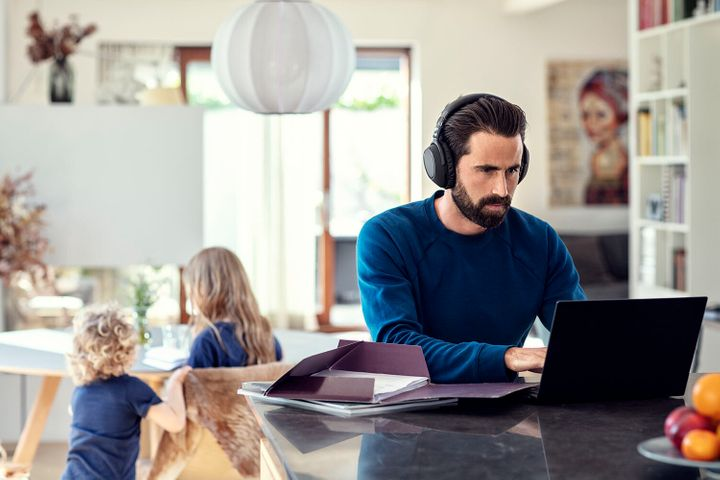 Man working from home - listening to headphones