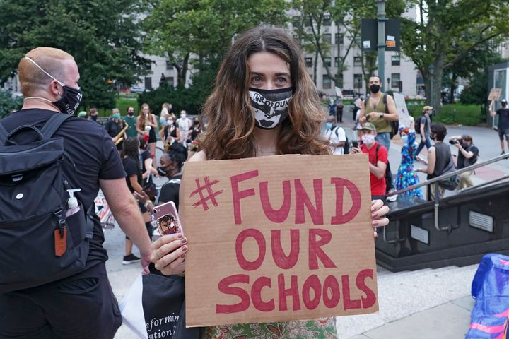 A protester holds a placard that says Fund Our Schools during a demonstration in New York City earlier this month. Several gr