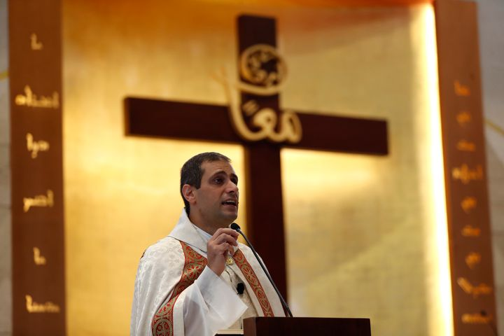 Lebanese priest Marwan Mouawad speaks during Sunday Mass at Saint Maron-Baouchrieh Church, which was damaged by last Tuesday'