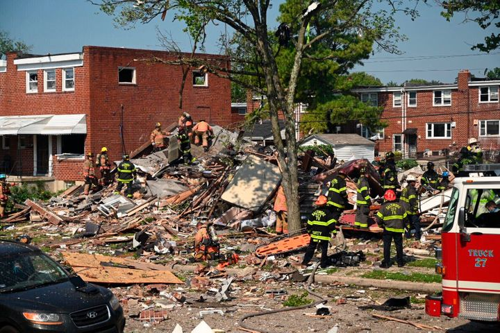 Firefighters search what remains of homes that were destroyed in a gas explosion Monday at Boxhill Road and Reisterstown Road