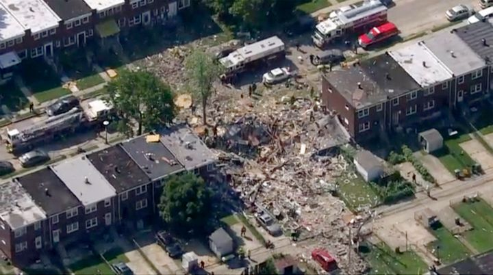Baltimore firefighters say a natural gas explosion leveled several homes in the city.