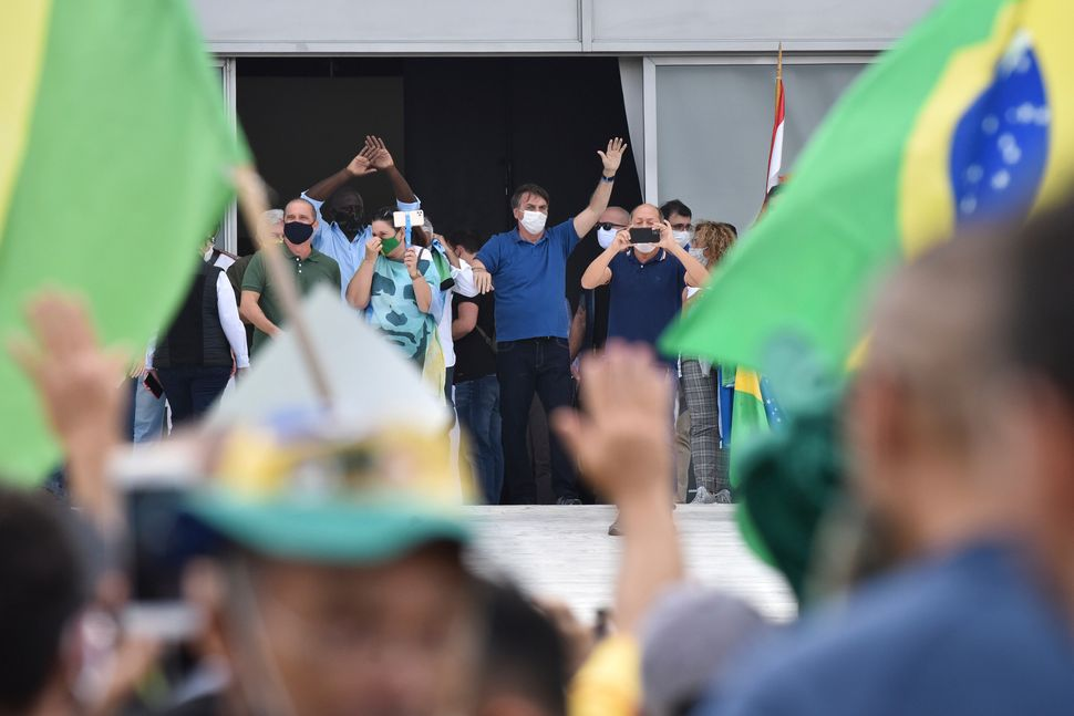 Throughout the pandemic, Bolsonaro has appeared at small protests where his most radical supporters have called for the closu