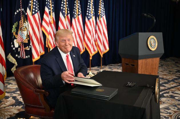 President Donald Trump signing executive orders extending coronavirus economic relief on Saturday. The...
