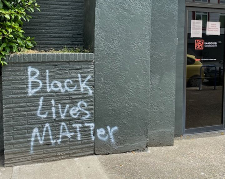 "The tagging happened in June, early on in the protests. As Portland has become a hotbed of clashes between federal forces and protesters, associate pastor Michelle Jones said the mural ""reminds those who see it that with so many things happening at the same time, justice matters."""