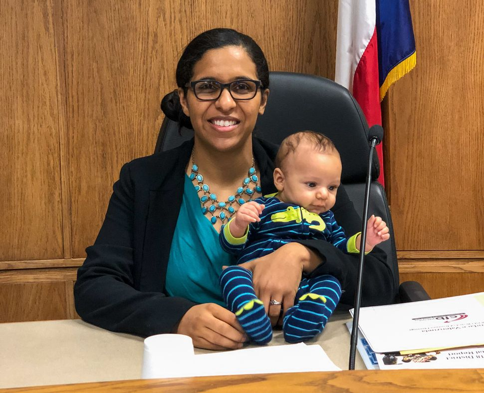 Valenzuela at a Carrollton-Farmers Branch school board meeting in August 2019 with her baby boy.