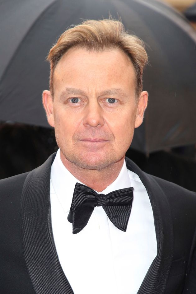 Jason Donovan poses for photographers upon arrival at the Olivier Awards in London, Sunday, April 8,