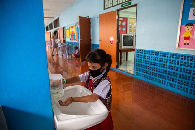 School In Thailand Uses Plastic Pens To Separate Students During