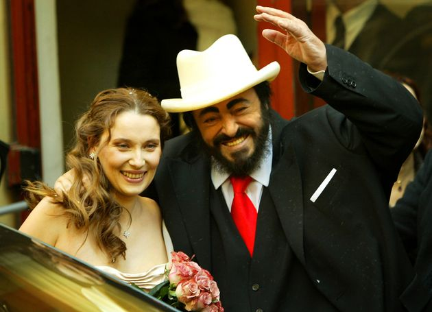 Italian opera singer Luciano Pavarotti and his new wife Nicoletta Mantovani as they leave their wedding...