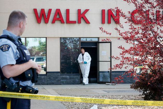 The Village Mall walk-in clinic is seen here in Red Deer, Alta., on Monday as police worked at the scene....