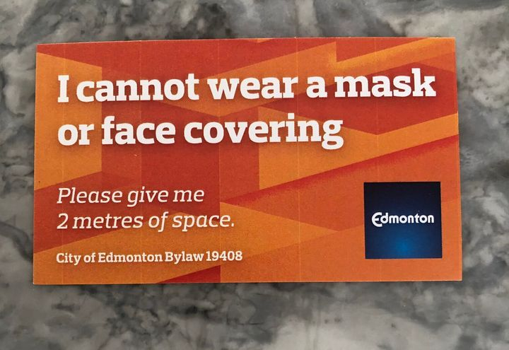 """One of the """"mask exemption"""" cards being distributed by the City of Edmonton."""