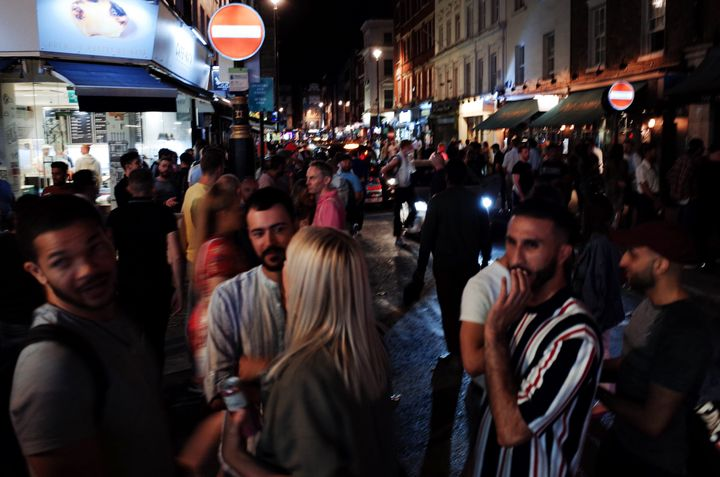 Revelers socialize on Old Compton Street in the hospitality and nightlife hotspot of Soho in London on July 18, 2020.