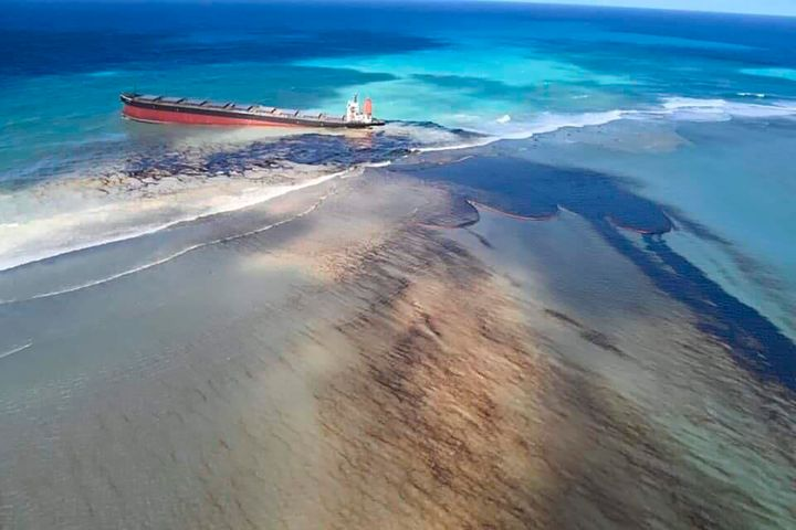 "Oil can be seen leaking from the MV Wakashio as Mauritius declared a ""state of environmental emergency."""