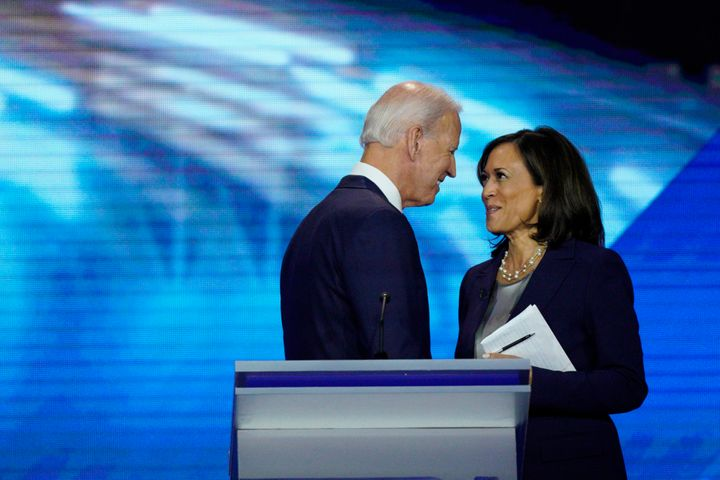 Democratic presidential candidates former Vice President Joe Biden, left, and Sen. Kamala Harris, D-Calif. shake hands Thursd