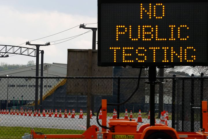 A sign is visible outside of Jim R. Miller Park during the first day of drive-thru coronavirus testing in Marietta, Georgia.&