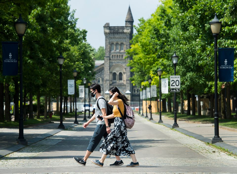 People walk past the University of Toronto campus during the COVID-19 pandemic in Toronto on Wednesday,...