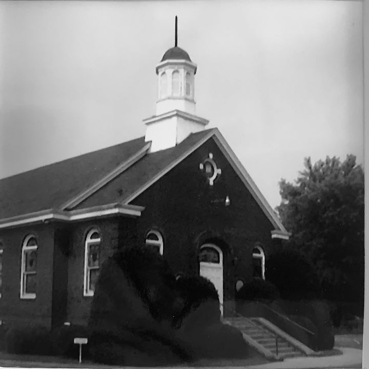 The writer's family attended this church for four generations. Her great grandmother was a charter member back around 1912. She took this photo and kept it on the wall of her office.