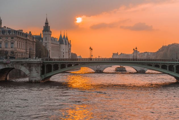 Sunset river sena paris, with boats and bridges in the