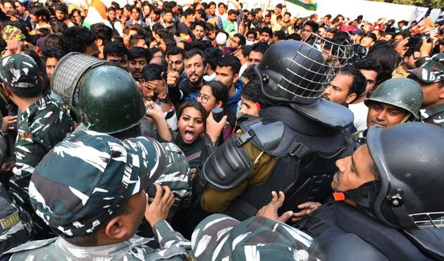 NEW DELHI, INDIA - FEBRUARY 10: Delhi police personnel and demonstrators in a scuffle during a march...