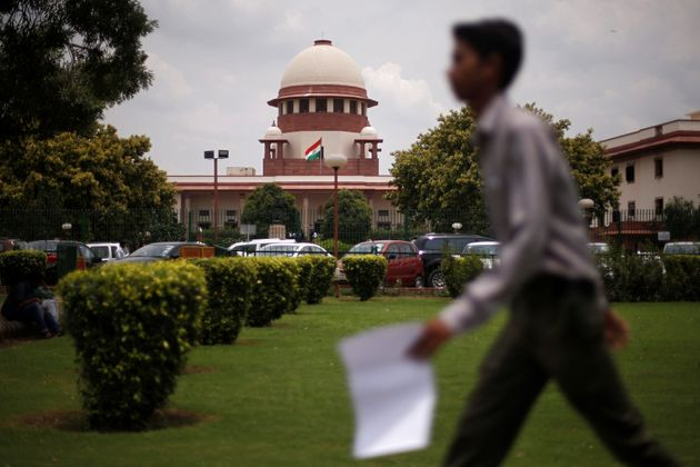 A man walks inside the premises of the Supreme Court in New Delhi, India, July 17, 2018. REUTERS/Adnan
