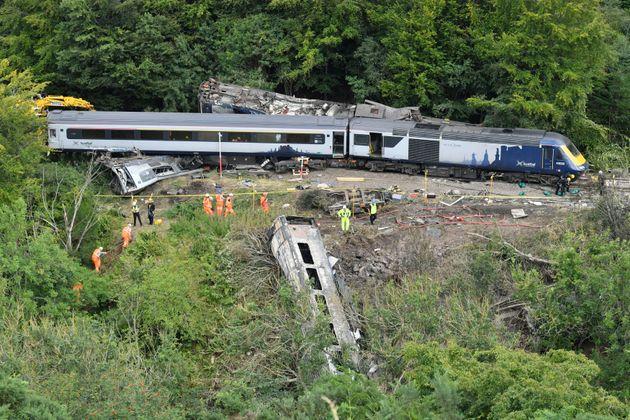 Emergency services inspect the scene following a train derailment near Stonehaven, Scotland
