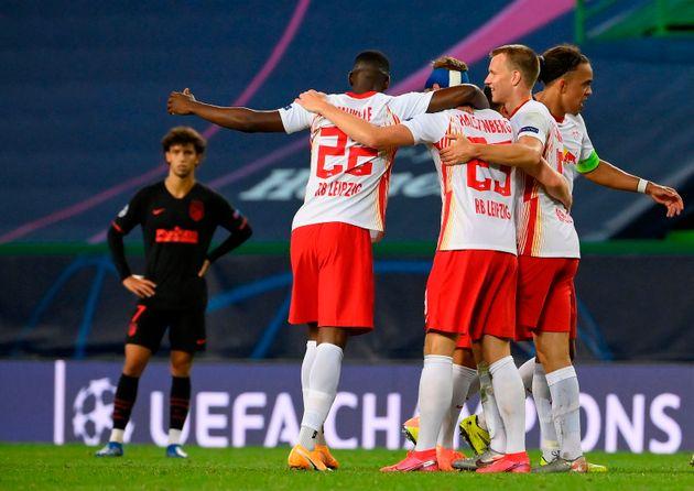 Les joueurs de Leipzig célébrant leur victoire face à l'Atlético Madrid ce...