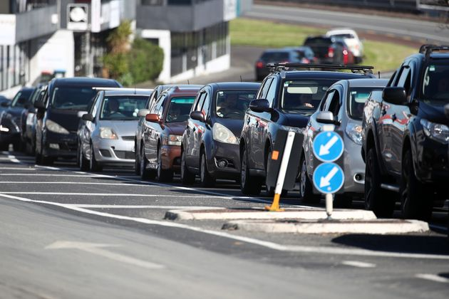 Cars line up outside a Covid-19 testing centre in Eden Terrace on August 13, 2020 in Auckland, New Zealand....
