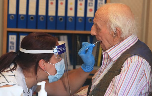 Assistant manager Claire Welford administers a coronavirus swab test on resident Harry Hall, 94, at the...
