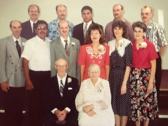 The writer's father's immediate family. She reconnected with her uncle Cliff, second from the left in the middle row. Her adoptive father appears in far right, in the back row.