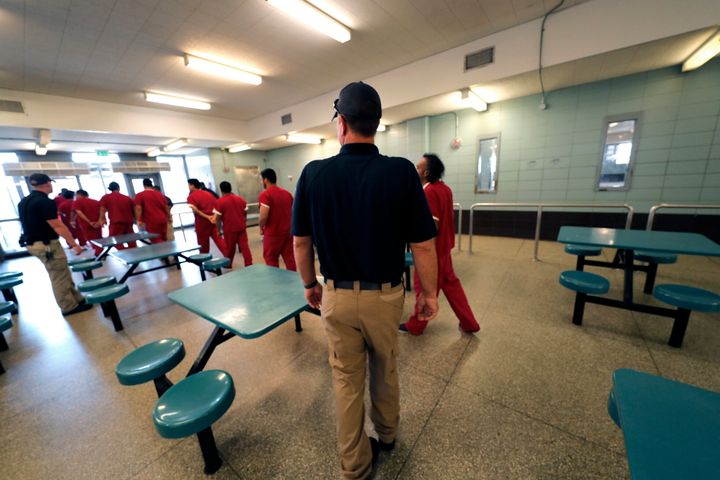 Detainees leave the cafeteria under the watch of guards during a media tour at the Winn Correctional Center in Winnfield, Lou