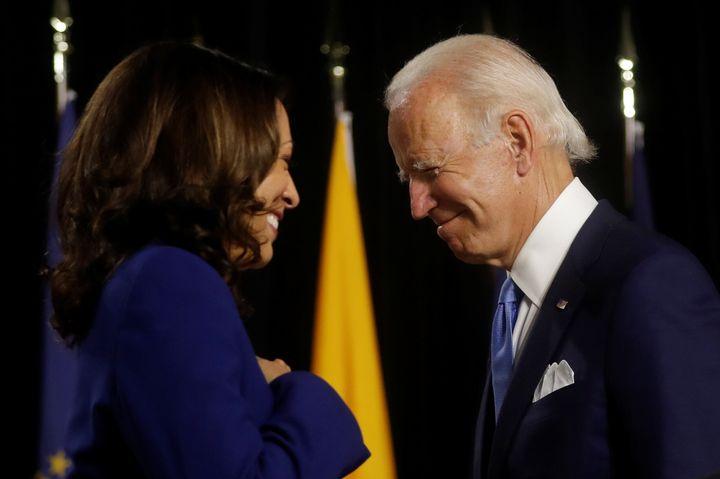 Presumptive Democratic presidential nominee Joe Biden (right) mentioned Kamala Harris' work on the Senate intelligence commit
