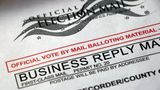 Closeup of a Vote by Mail envelope, official balloting material - business reply mail, USPS first class mail.