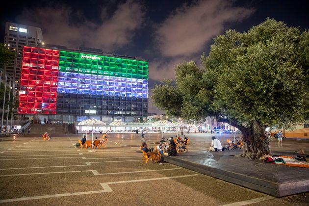Tel Aviv City Hall is lit up with the flags of the United Arab Emirates and Israel as the countries announced...