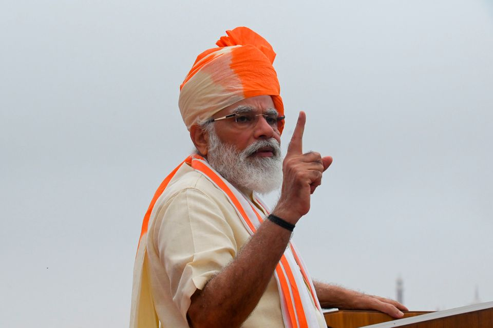 India's Prime Minister Narendra Modi gestures as he delivers a speech to the nation during a ceremony...