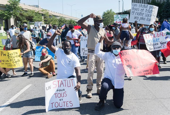 Protesters calling for the government to give residency to all migrant workers and asylum seekers gathered in front of Prime Minister Justin Trudeau's constituency office in Montreal, on Aug. 1st.