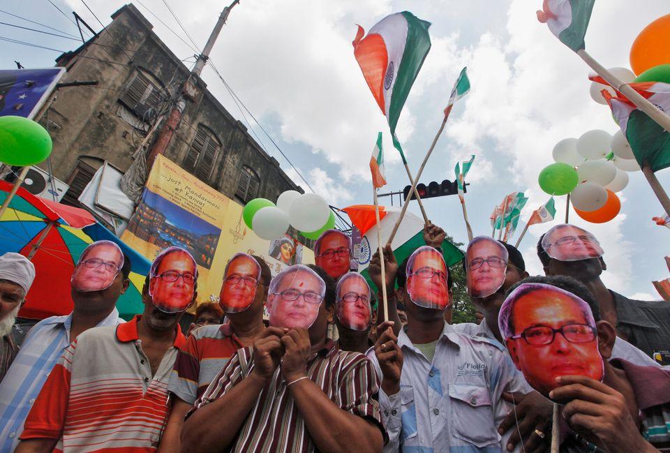 A 2012 photo of Congress workers in Kolkata celebrating Mukherjee becoming