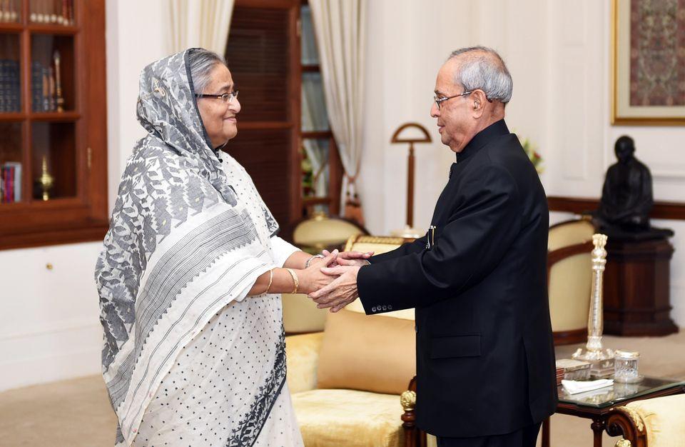 President Pranab Mukherjee (R) greets Bangladeshi Prime Minister Sheikh Hasina (L) moments after the...