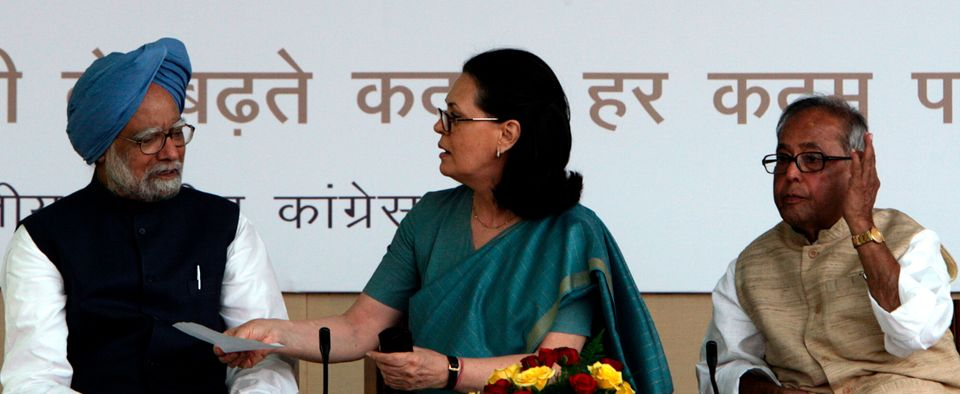 A 2009 photo of Sonia Gandhi speaking to then Prime Minister Manmohan Singh as Foreign Minister Mukherjee...