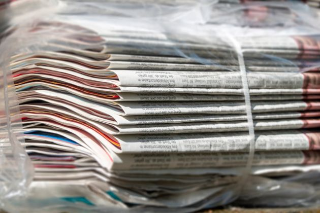 Stack of bundled newspapers, ready to be