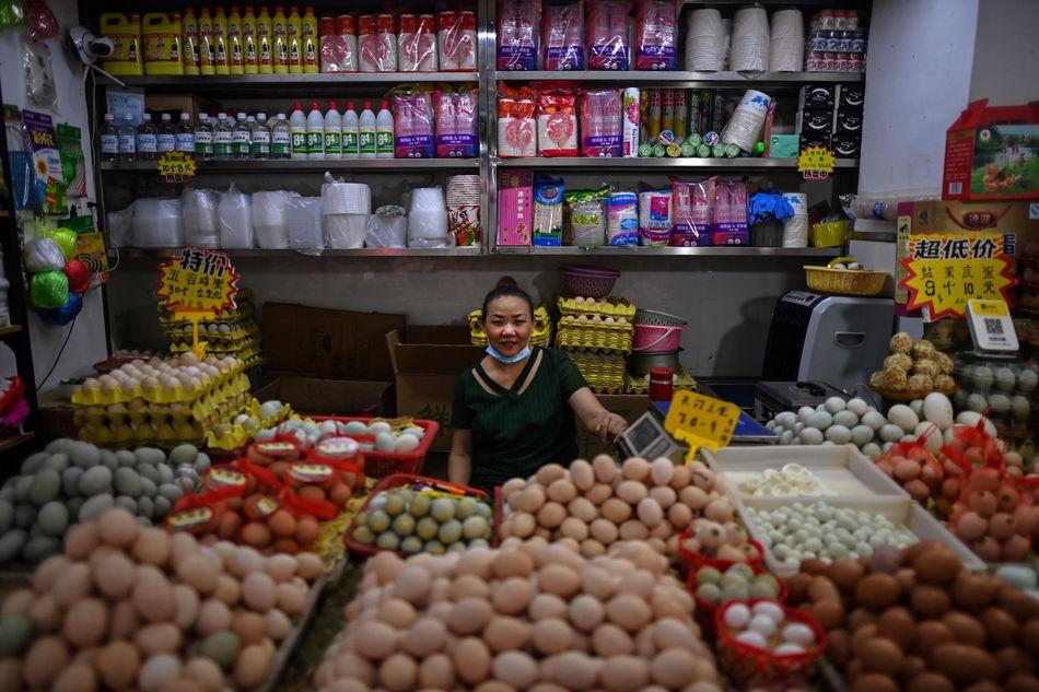En el mercado central de Wuhan.;