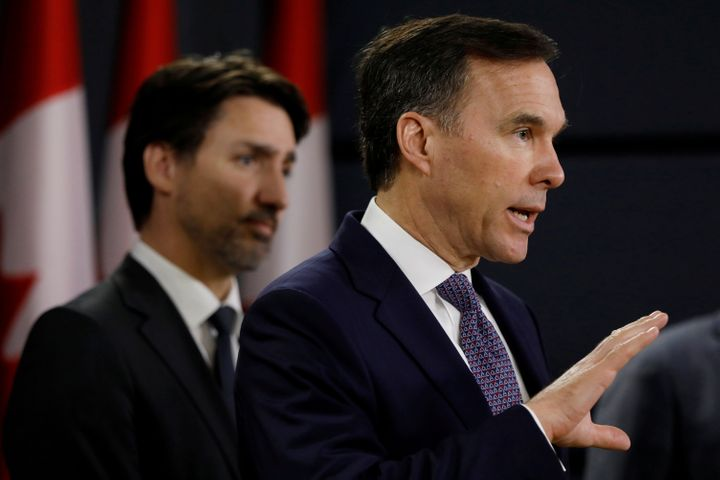 Federal Finance Minister Bill Morneau addresses the media during a news conference on March 11 in Ottawa with Prime Minister Justin Trudeau behind him. Morneau has been finance minister since the Liberals took power in late 2015.
