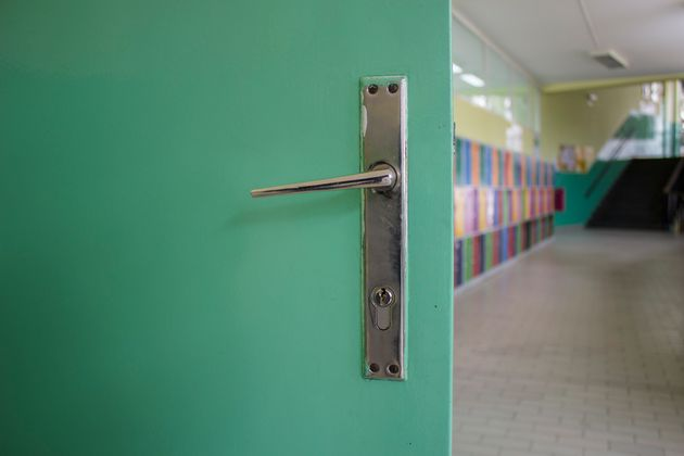 The old green door of the elementary school classroom