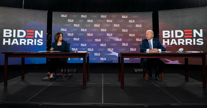 Democratic presidential candidate former Vice President Joe Biden and running mate Sen. Kamala Harris, D-Calif., look to each